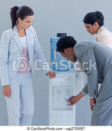 Business team with a water cooler in office - csp2705087
