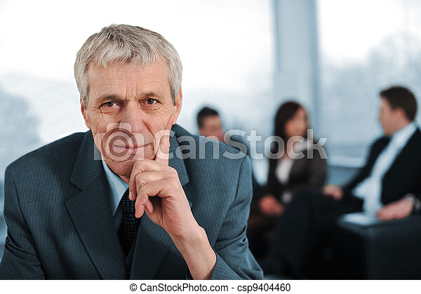 Business team with manager sitting in front - csp9404460