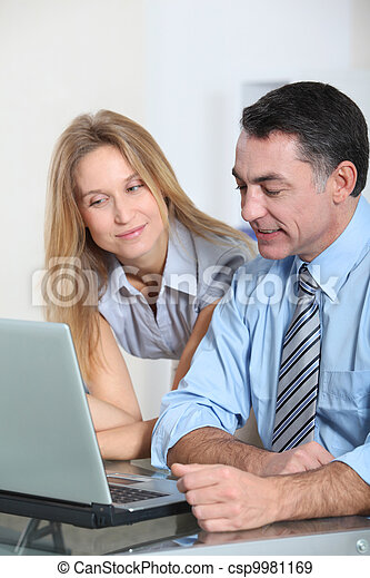 Business team working in the office - csp9981169