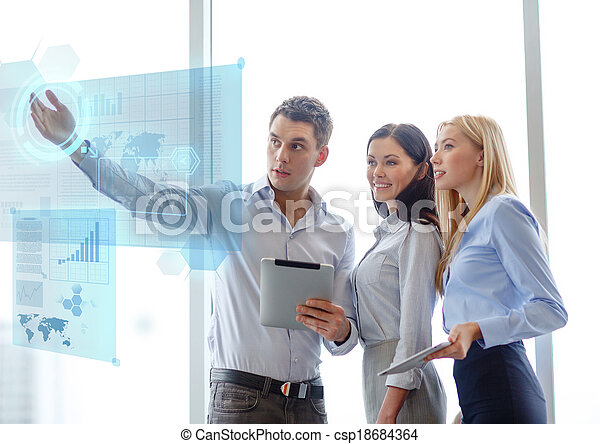 business team working with tablet pcs in office - csp18684364
