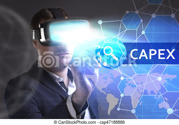 Business, Technology, Internet and network concept. Young businessman working in virtual reality glasses sees the inscription: Capex - csp47188886