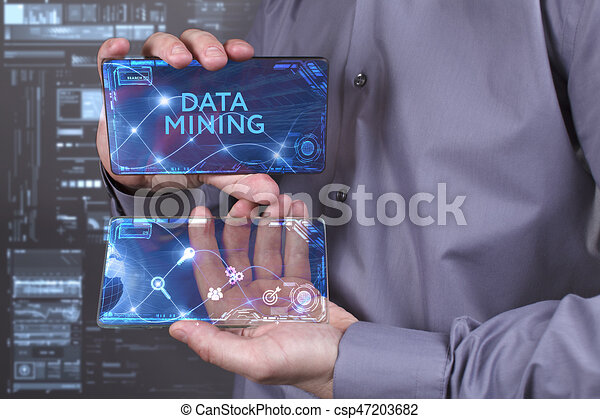 Business, Technology, Internet and network concept. Young businessman working on a virtual screen of the future and sees the inscription: Data mining - csp47203682
