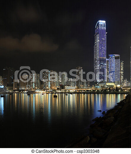Business Towers and Residential Apartment Buildings in Hong Kong at night - csp3303348