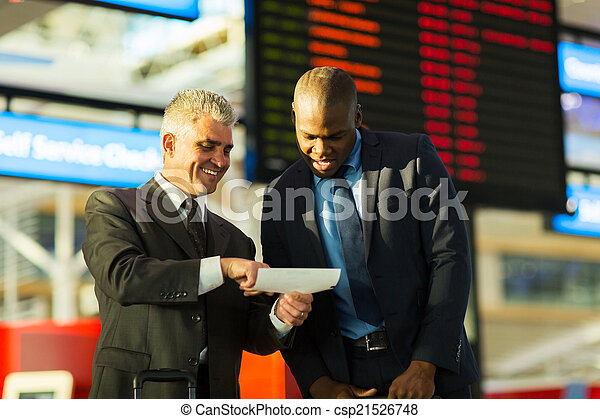 business travellers looking at air ticket - csp21526748