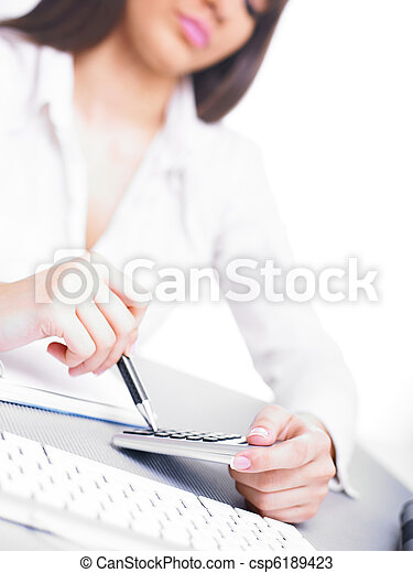Business woman calculating with calculator and pencil - csp6189423