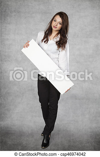 business woman holds a copy space in hands - csp46974042