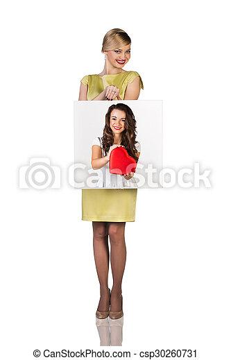Business woman holds portrait - csp30260731