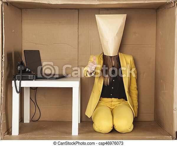 business woman in a minimalist office shows the thumb upwards - csp46976073