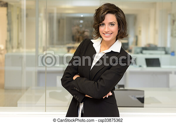 Business woman in an office. Crossed arms - csp33875362