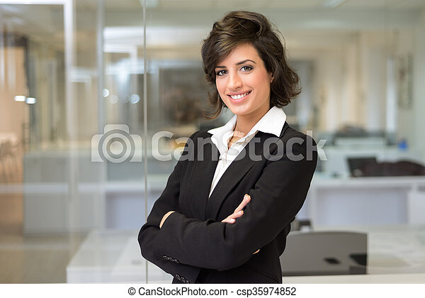Business woman in an office. Crossed arms - csp35974852