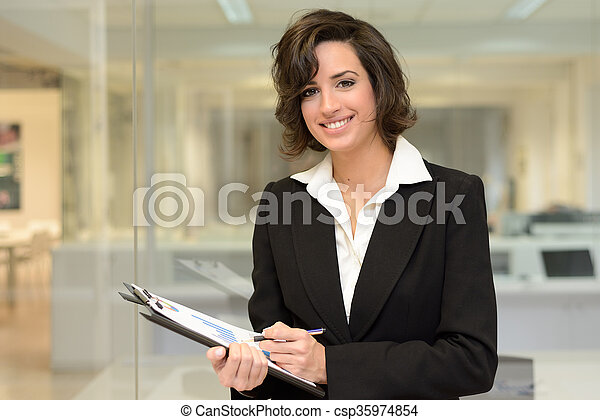 Business woman in an office. - csp35974854