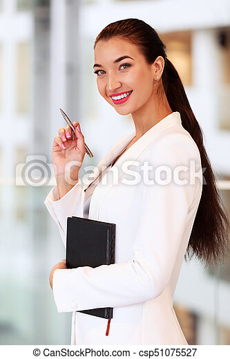 Business woman in an office - csp51075527