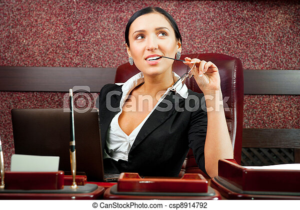 Business woman in an office - csp8914792