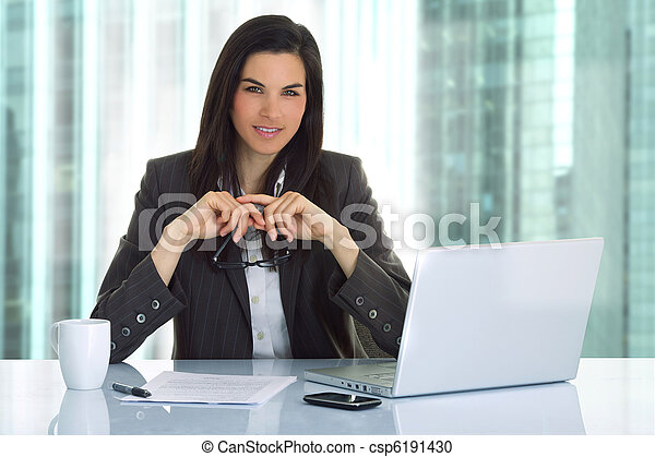 Business woman in an office  - csp6191430