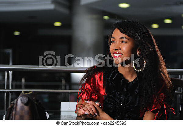 business woman in red dress smilling - csp2245593