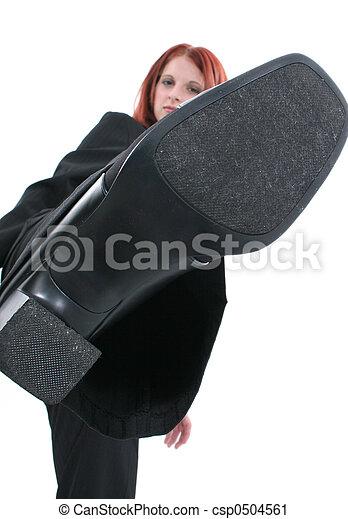 Business Woman Kicking Business Woman Kicking At Camera