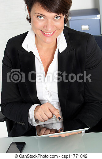 Business woman looking up and smiling - csp11771042