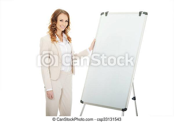 Business woman near flipchart. - csp33131543