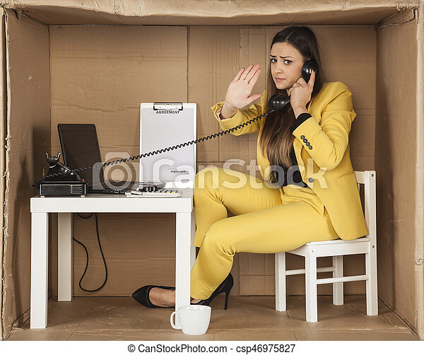 business woman performs a gesture stop during a telephone conversation - csp46975827