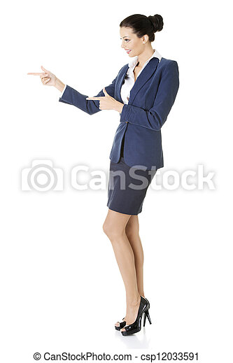 Business woman pointing on copy space - csp12033591