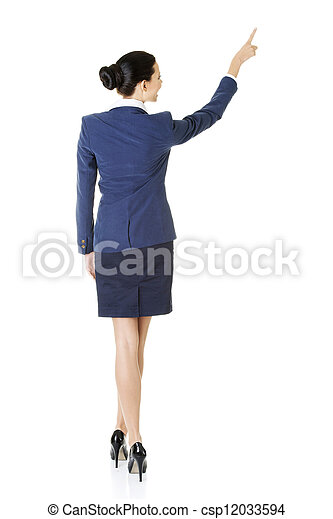 Business woman pointing on copy space - csp12033594