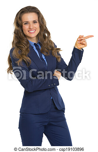 Business woman pointing on copy space - csp19103896