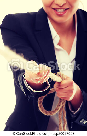 Business woman pulling on a piece of rope - csp20027093