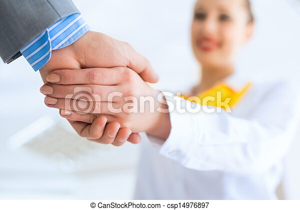 business woman shaking hands with a client - csp14976897