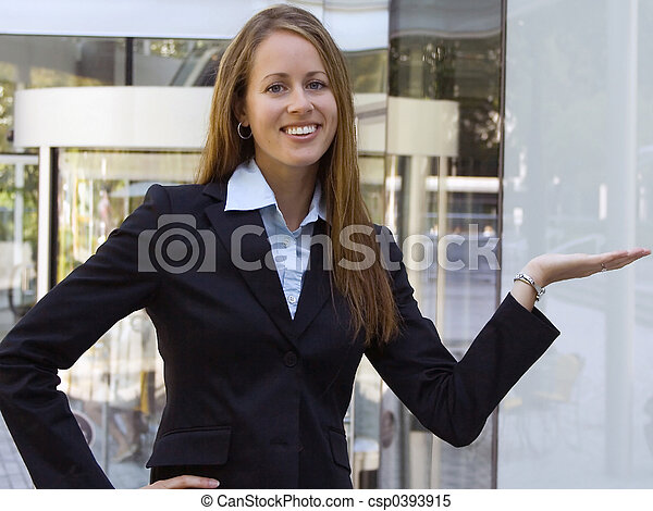 Business Woman - Showing a product in her hand. - csp0393915