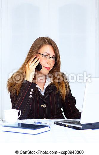 Business woman sitting at the workplace - csp3940860
