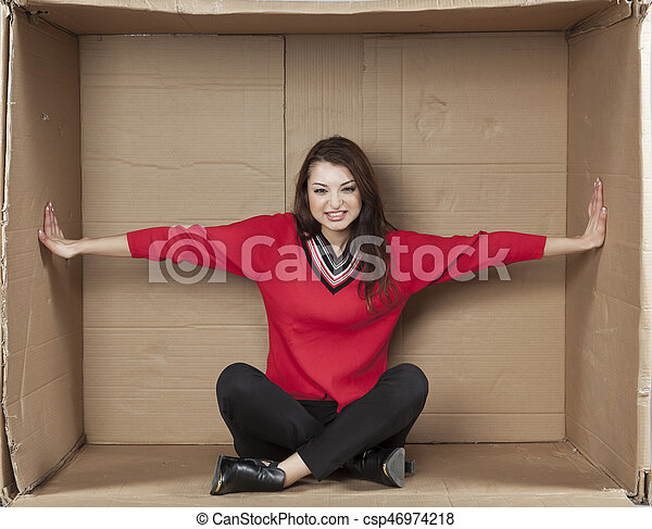 business woman sitting in a cramped office - csp46974218