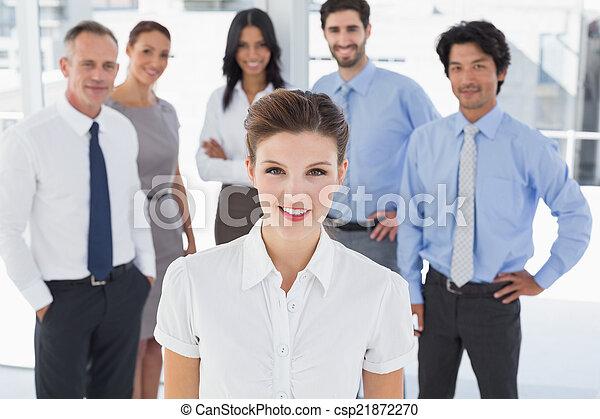 Business woman smiling at camera - csp21872270