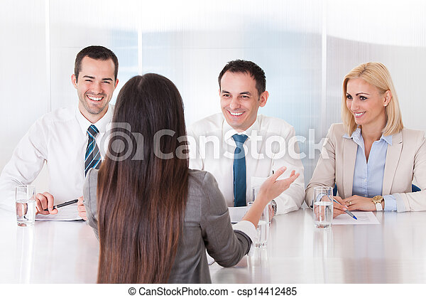 Business Woman Speaking At Interview - csp14412485