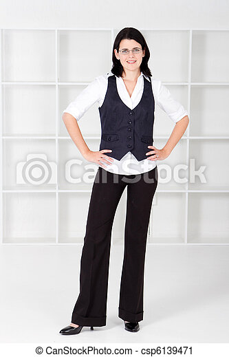 business woman standing in office - csp6139471