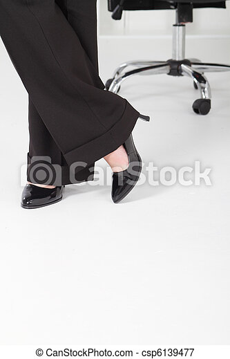 business woman standing in office - csp6139477