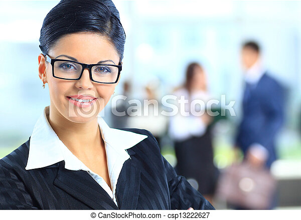 business woman standing with her staff in background - csp13222627