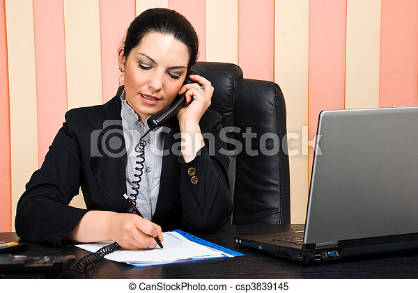 Business woman talking by phone and write on paper - csp3839145