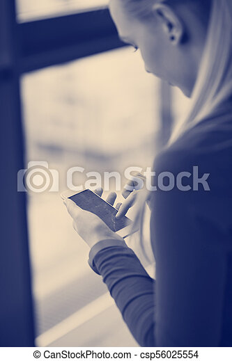 business woman using smart phone at office - csp56025554