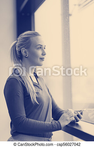 business woman using smart phone at office - csp56027042