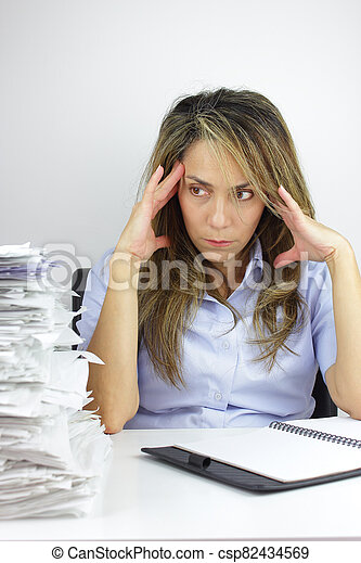 Business woman with a headache - csp82434569