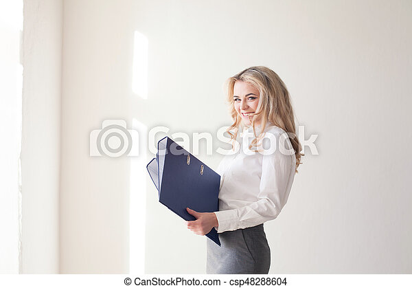 business woman with folders of documents - csp48288604
