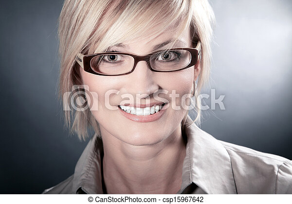 business woman with glasses looks - csp15967642