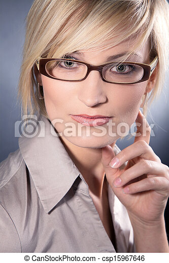 business woman with glasses looks - csp15967646