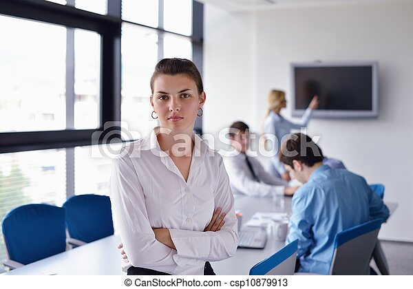 business woman with her staff in background at office - csp10879913
