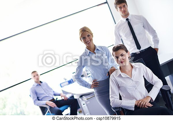 business woman with her staff in background at office - csp10879915