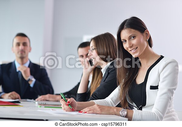 business woman with her staff in background at office - csp15796311