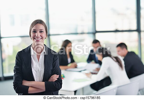 business woman with her staff in background at office - csp15796185