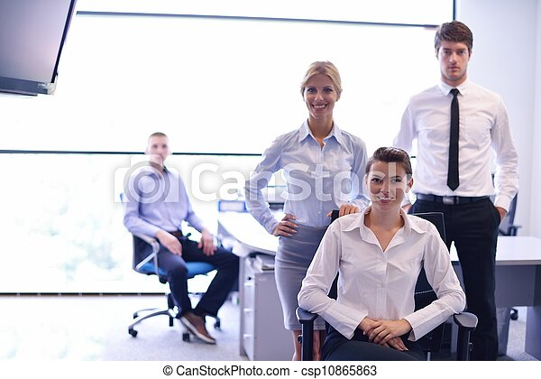 business woman with her staff in background at office - csp10865863