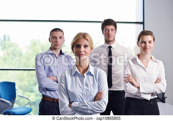 business woman with her staff in background at office - csp10865855