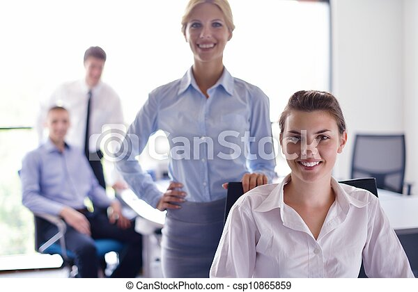 business woman with her staff in background at office - csp10865859